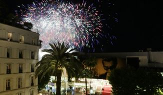 A fireworks show prior to arrivals on the red carpet for a screening of Timbuktu at the 67th international film festival, Cannes, southern France, Thursday, May 15, 2014. (AP Photo/Virginia Mayo)