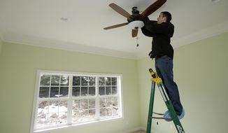 In this Friday, March 21, 2014 photo, Pete Christman installs a remote control for a fan in a new home in Pepper Pike, Ohio. The National Association of Home Builders reports on sentiment among U.S. builders on Thursday, May 15, 2014. (AP Photo/Tony Dejak)
