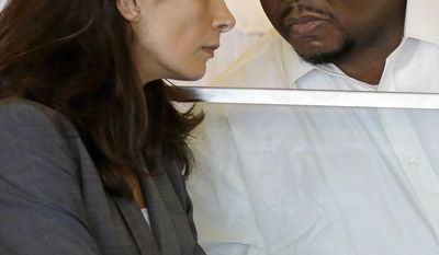 Attorney Melinda Thompson confers with her  her client Ernest Wallace, right, an associate of former New England Patriots tight end Aaron Hernandez, during his arraignment in Bristol Superior Court Thursday, May 15, 2014 in Fall River, Mass. Prosecutors have Wallace back in court to upgrade his charges from accessory to murder after the fact to murder in the death of semi-professional football player Odin Lloyd. (AP Photo/Stephan Savoia)