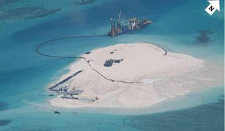 In this photo taken Feb. 25, 2014 by surveillance planes and released Thursday, May 15, 2014, by the Philippine Department of Foreign Affairs, a Chinese vessel, top center, is used to expand structures and land on the Johnson Reef, called Mabini by the Philippines and Chigua by China, at the Spratly Islands at South China Sea, Philippines. The Philippines has protested China's reclamation of land in the disputed reef in the South China Sea that can be used to build an airstrip or an offshore military base in the increasingly volatile region, the country's top diplomat and other officials said Wednesday, May 14, 2014.  The white arrow was added by the source. (AP Photo/Philippine Department of Foreign Affairs)