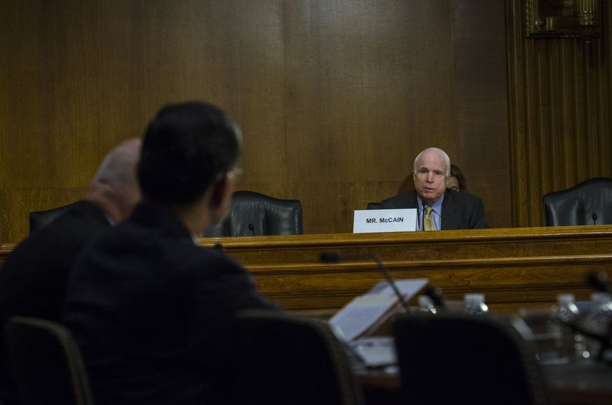 """Senator John McCain (R-AZ) who is not on the committee but was asked to join in the hearing, asks a question of Department of Veterans Affairs Secretary Eric Shinseki and Under Secretary for Health, Department of Veterans Affairs, Robert A. Petzel, during their testimony at a Senate Veterans Affairs Committee hearing titled """"The State of VA Health Care"""" in the Dirksen Senate Office Building in Washington, DC., Tuesday, May 13, 20124. (Photo Rod Lamkey Jr.)"""