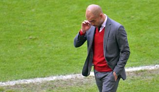 Bayern head coach Pep Guardiola  walks at the sideline of the pitch  during the  soccer match between FC Bayern Munich and VfB Stuttgart in the Allianz Arena in Munich, Germany, on Saturday, May 10. 2014. (AP Photo/Kerstin Joensson)