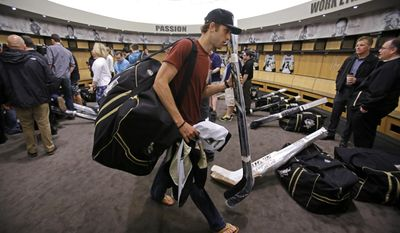 Pittsburgh Penguins' Brandon Sutter carries his gear after clearing out his locker at the Consol Energy Center in Pittsburgh, Thursday, May 15, 2014. (AP Photo/Gene J. Puskar)