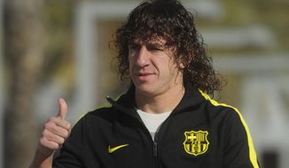 FILE  -  In this Nov. 27, 2010 file photo FC Barcelona's Carles Pujol gestures,  in San Joan Despi, near Barcelona, Spain. Puyol reluctantly quit football on Thursday, May 15, 2014,  his knees no longer able to endure the demands of the Barcelona defense after 15 years, the most successful period in the club's history. (AP Photo/Manu Fernandez, File)