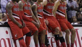 Portland Trail Blazers starters, from left, Wesley Matthews, LaMarcus Aldridge, Damian Lillard, Robin Lopez, and Nicolas Batum, sit on the scorers table during a timeout in the second half of Game 5 of a Western Conference semifinal NBA basketball playoff series against the San Antonio Spurs, Wednesday, May 14, 2014, in San Antonio. San Antonio won 104-82. (AP Photo/Eric Gay)