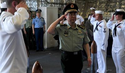 Gen. Fang Fenghui, chief of the general staff of China's People's Liberation Army, salutes while visiting the USS Coronado Tuesday in San Diego. (associated press)