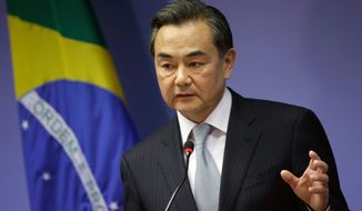 The newspaper, which often reflects Beijing's official policy line, also reported that Chinese Foreign Minister Wang Yi defended Beijing's deployment of the oil rig, asserting during a phone conversation with his Indonesian counterpart Wednesday that the area where the rig is positioned is part of Chinese sovereign territory. (AP Photo/Eraldo Peres)