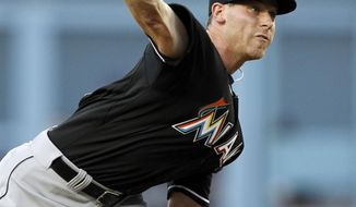 Miami Marlins starting pitcher Anthony DeSclafani throws against the Los Angeles Dodgers in the first inning of a baseball game Wednesday, May 14, 2014, in Los Angeles. (AP Photo/Alex Gallardo)
