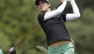 Azahara Munoz, of Spain, watches her tee shot on the ninth hole during the first round of the Kingsmill Championship golf tournament at the Kingsmill resort in Williamsburg, Va., Thursday, May 15, 2014.  (AP Photo/Steve Helber)