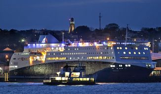 A Casco Bay Lines ferry passes by the Nova Star ferry as the 528-foot, $165 million ship prepares to make its maiden voyage from Portland, Maine to Yarmouth, Nova Scotia, Canada, Thursday, May 15, 2014. (AP Photo/Robert F. Bukaty)