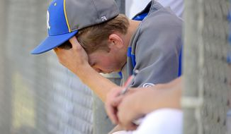 In this photo taken Tuesday, May 13, 2014, Rochester High School pitcher Dylan Fosnacht rests between the 13th and 14th inning of a District IV 1A baseball tournament first-round game against La Center, at Rochester High School in Rochester, Wash. Fosnacht threw 194 pitches as he took a shutout into the 15th inning. His team beat La Center 1-0 in 17 innings. (AP Photo/The Chronicle, Pete Caster)