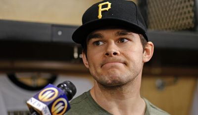 Pittsburgh Penguins' Chris Kunitz listens to a reporter's question during locker clean out day at the Consol Energy Center in Pittsburgh, Thursday, May 15, 2014. (AP Photo/Gene J. Puskar)