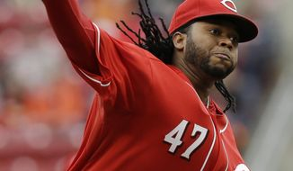 Cincinnati Reds starting pitcher Johnny Cueto throws against the San Diego Padres in the first inning of a baseball game, Thursday, May 15, 2014, in Cincinnati. (AP Photo/Al Behrman)