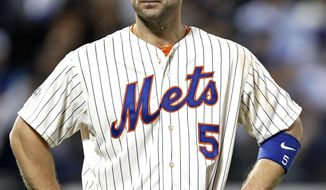 New York Mets' David Wright stands after grounding out in the eighth inning with a runner in scoring position in a baseball game against the New York Yankees in New York, Thursday, May 15, 2014. (AP Photo/Kathy Willens)