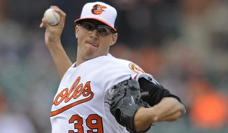 Baltimore Orioles pitcher Kevin Gausman delivers against the Detroit Tigers in the first inning of a baseball game Wednesday, May 14, 2014, in Baltimore. (AP Photo/Gail Burton)