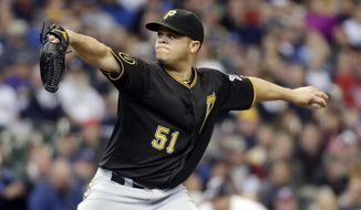 Pittsburgh Pirates starting pitcher Wandy Rodriguez throws during the first inning of a baseball game against the Milwaukee Brewers Thursday, May 15, 2014, in Milwaukee. (AP Photo/Morry Gash)
