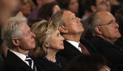 From left, Former U.S. President Bill Clinton sits with his wife former U.S. Secretary of State Hillary Clinton, former New York Governor George Pataki and former New York City Mayor Rudolph Giuliani during the dedication ceremony at the National September 11 Memorial Museum in New York, Thursday,  May 15, 2014.  (AP Photo/Mike Segar, Pool)
