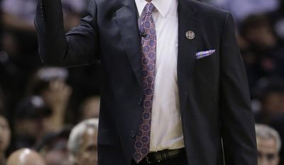 Portland Trail Blazers coach Terry Stotts calls to his players during the first half of Game 5 of a Western Conference semifinal NBA basketball playoff series against the San Antonio Spurs, Wednesday, May 14, 2014, in San Antonio. (AP Photo/Eric Gay)