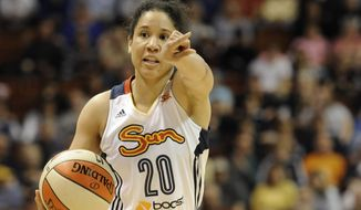 Connecticut Sun's Kara Lawson dribbles the ball during the second half of a WNBA basketball game against New York in Uncasville, Conn., Saturday, May 25, 2013.  (AP Photo/Jessica Hill)