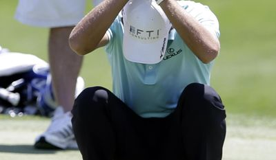 Charles Howell III reacts to his long birdie putt attempt that stopped inches short of the hole on the 17th green during the opening round of the Byron Nelson Championship golf tournament, Thursday, May 15, 2014, in Irving, Texas. (AP Photo/Tony Gutierrez)