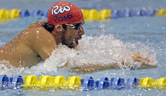 Michael Phelps warms up before the Charlotte Grand Prix swimming event in Charlotte, N.C., Thursday, May 15, 2014. (AP Photo/Chuck Burton)