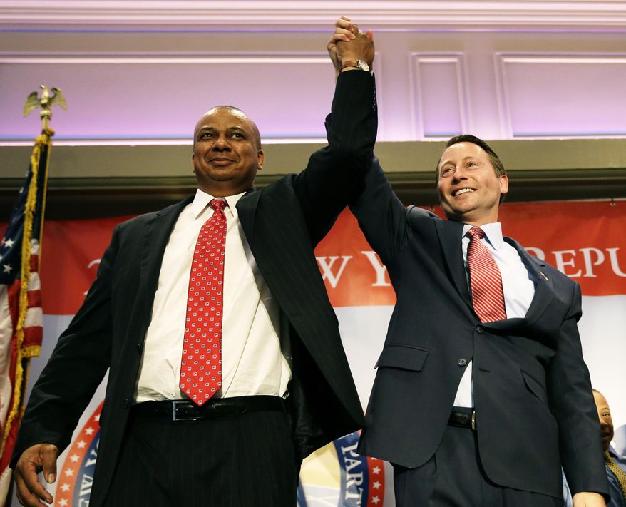 The Republican nominees Rob Astorino, right, for governor and Christopher Moss for lieutenant governor, stand together on stage during the New York State Republican Convention in Rye Brook, N.Y., Thursday, May 15, 2014. Republicans wrapped up their state party convention Thursday in Westchester County after nominating Astorino and other candidates for statewide office.   (AP Photo/Seth Wenig)