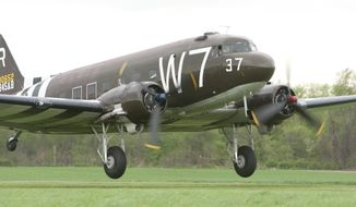 "The C-47 'Whiskey 7' starts its takeoff for the ""Return to Normandy"" project being carried out by the Geneseo National Warplane Museum in Geneseo, N.Y., on Thursday May 15 2014. The Douglas C-47, a World War II transport plane that dropped American paratroopers on Normandy departed from Geneseo, in New York Thursday for a D-Day 70th anniversary commemoration in France. (AP Photo/Democrat & Chronicle, Carlos Ortiz) ** FILE **"