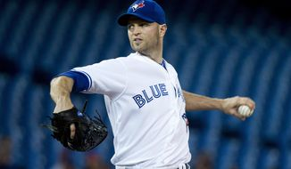 Toronto Blue Jays starting pitcher J.A. Happ works against the Cleveland Indians during first inning of baseball game in Toronto on Thursday, May 15, 2014.  (AP Photo/The Canadian Press, Nathan Denette)