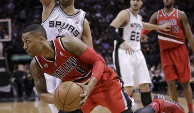 Portland Trail Blazers' Damian Lillard (0) drives around San Antonio Spurs' Tony Parker during the first half of Game 5 of a Western Conference semifinal NBA basketball playoff series, Wednesday, May 14, 2014, in San Antonio. (AP Photo/Eric Gay)