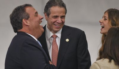 New Jersey Governor Chris Christie, left, and New York Gov. Andrew M. Cuomo talk at the dedication of the National September 11 Memorial Museum  in New York, May 15, 2014.  (AP Photo/Timothy A. Clary, Pool.)