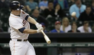 Houston Astros' Matt Dominguez hits an RBI single against the Texas Rangers in the ninth inning of a baseball game Wednesday, May 14, 2014, in Houston. The Astros won 5-4. (AP Photo)