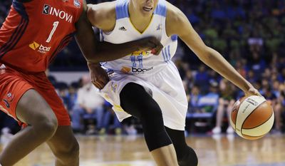 FILE - In this July 10, 2013 file photo, Chicago Sky forward Elena Delle Donne, right, drives against Washington Mystics forward Crystal Langhorne during an WNBA basketball game in Rosemont, Ill. The Chicago Sky had their first winning season in 2013 but may struggle to match it with an unsettled lineup. Holes in the lineup likely means a heavier load for forward Delle Donne, the 2013 WNBA rookie of the year. (AP Photo/Nam Y. Huh, File)
