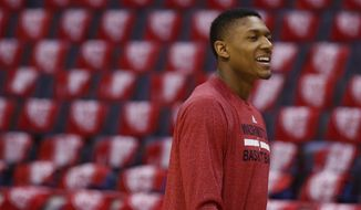Washington Wizards guard Bradley Beal (3) walk though the empty arena before Game 4 of an Eastern Conference semifinal NBA basketball playoff game in Washington, Sunday, May 11, 2014. (AP Photo/Alex Brandon)