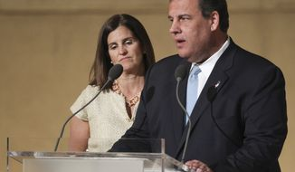 New Jersey Gov. Chris Christie speaks with his wife Mary Pat Christie at his side during the dedication ceremony at the National September 11 Memorial Museum on Thursday, May 15, 2014 in New York.  (AP Photo/The Star-Ledger, John Munson, Pool)