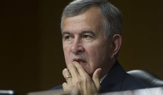 Sen. Mike Johanns, R-Neb. listens as Veterans Affairs Secretary Eric Shinseki testifies on Capitol Hill in Washington, Thursday, May 15, 2014, before the Senate Veterans Affairs Committee hearing to examine the state of Veterans Affairs health care. (AP Photo/Cliff Owen)