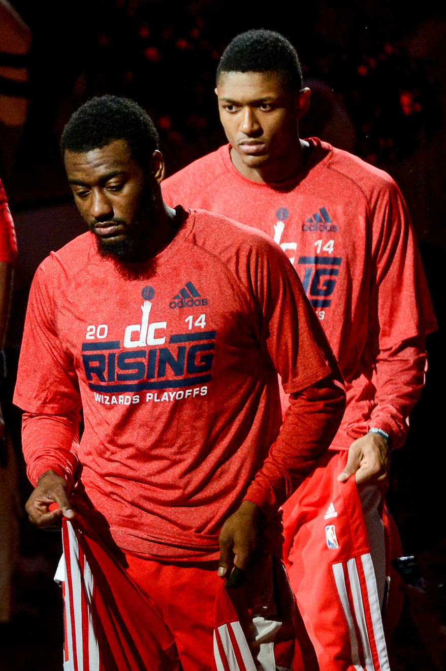 Washington Wizards guard John Wall (2), left, and Washington Wizards guard Bradley Beal (3), right, are introduced before the Washington Wizards play the Indiana Pacers during game 6 of the 2nd round of the NBA Playoffs at the Verizon Center, Washington, D.C., Thursday, May 15, 2014. (Andrew Harnik/The Washington Times)