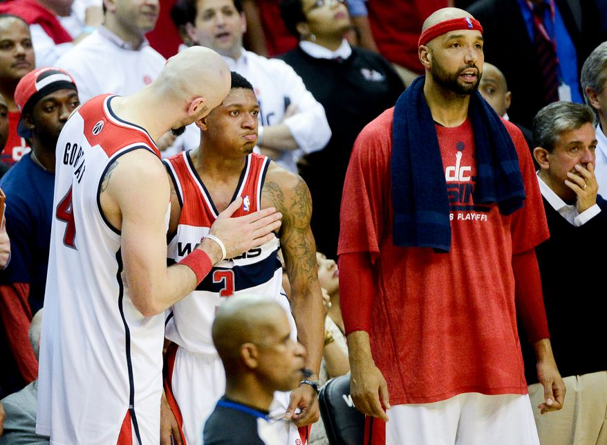 Washington Wizards forward Drew Gooden (90) watches as Washington Wizards center Marcin Gortat (4) comforts Washington Wizards guard Bradley Beal (3) as the Washington Wizards lose to the Indiana Pacers, 93-80, during game 6 of the 2nd round of the NBA Playoffs at the Verizon Center, Washington, D.C., Thursday, May 15, 2014. (Andrew Harnik/The Washington Times)