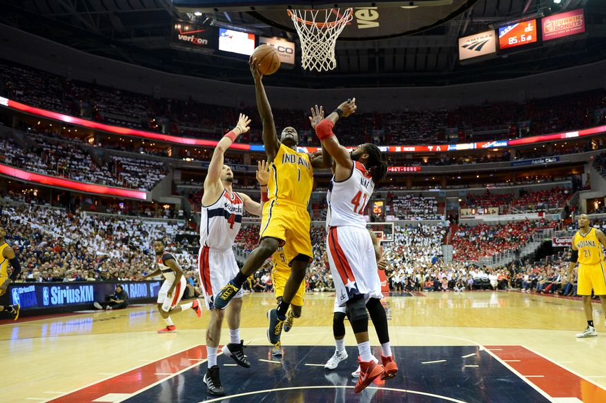 Indiana Pacers guard Lance Stephenson (1) shoots between Washington Wizards center Marcin Gortat (4), left, and Washington Wizards forward Nene Hilario (42), right, as the Washington Wizards lose to the Indiana Pacers, 93-80, during game 6 of the 2nd round of the NBA Playoffs at the Verizon Center, Washington, D.C., Thursday, May 15, 2014. (Andrew Harnik/The Washington Times)