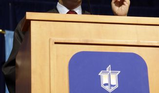 Wisconsin Gov. Scott Walker gives a commencement speech at Concordia University of Wisconsin Friday, May 16, 2014, in Mequon, Wis. (AP Photo/Morry Gash)