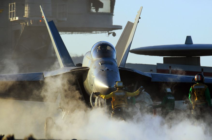 An F/A-18E Super Hornet is prepared for take-off from USS George Washington  INDIAN OCEAN (July 18, 2011) An F/A-18E Super Hornet assigned to the Eagles of Strike Fighter Squadron (VFA) 115 is prepared for take-off from the aircraft carrier USS George Washington (CVN 73). George Washington is participating in Exercise Talisman Sabre 2011, a bilateral exercise intended to train Australian and U.S. forces in planning and conducting combined task force operations. (U.S. Navy photo by Mass Communication Specialist 2nd Class Adam K. Thomas/Released) 110718-N-DS193-023