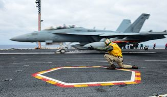 """PACIFIC OCEAN (March 24, 2014) Lt. Sean Dougherty, from Quakertown, Pa., shoots an EA-18G Growler assigned to the """"Gauntlets†of Electronic Attack Squadron (VAQ) 136 from a catapult on the flight deck of the aircraft carrier USS Ronald Reagan (CVN 76). Ronald Reagan is underway conducting tailored ship's training availability. (U.S. Navy photo by Mass Communication Specialist Seaman Jonathan Nelson/Released) 140324-N-WO404-275Join the conversationhttp://www.navy.mil/viewGallery.asphttp://www.facebook.com/USNavyhttp://www.twitter.com/USNavyhttp://navylive.dodlive.milhttp://pinterest.comhttps://plus.google.com"""