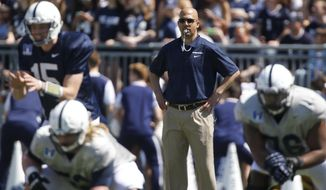In this April 12, 2014, photo, Penn State coach James Franklin watches the NCAA college football team's annual Blue-White spring scrimmagein State College, Pa. Franklin is trying to inject Penn State with the enthusiasm he brought to Vanderbilt. (AP Photo/Keith Srakocic)