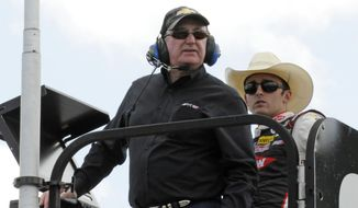Team owner Richard Childress, front, and driver Austin Dillon, back, watch practice for Saturday's NASCAR Sprint Cup series auto race at Charlotte Motor Speedway in Concord, N.C., Friday, May 16, 2014. (AP Photo/Mike McCarn)