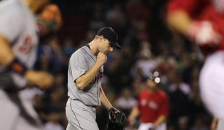 Detroit Tigers starting pitcher Max Scherzer pumps his fist after getting Boston Red Sox's Grady Sizemore to ground into a double play during the sixth inning of a baseball game at Fenway Park in Boston, Friday, May 16, 2014. (AP Photo/Charles Krupa)