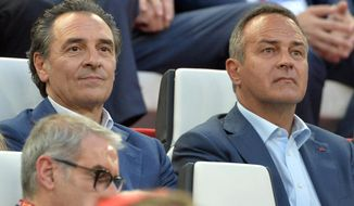 Cesare Prandelli, left, coach of the Italian national soccer team, sits beside 1982 World champion Antonio Cabrini, during the Europa League soccer final between Sevilla and Benfica, at the Turin Juventus stadium in Turin, Italy, Wednesday, May 14, 2014. (AP Photo/Massimo Pinca)