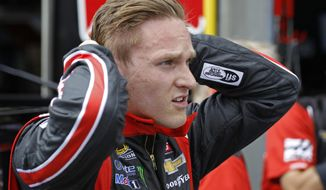 Parker Kligerman talks to crew members after driving Kurt Busch's car during practice for Saturday's NASCAR Sprint Cup series auto race at Charlotte Motor Speedway in Concord, N.C., Friday, May 16, 2014. Kligerman will fill in for Kurt Busch during race activities leading up to the All-Star and Coca-Cola 600 races. (AP Photo/Terry Renna)