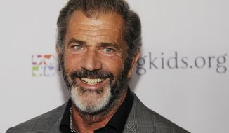 "FILE - In this Feb. 14, 2014 file photo, actor-director Mel Gibson poses at the Mending Kids ""Rock N' Roll All Star Event"" in West Hollywood, Calif. Court records show that a Los Angeles court vacated Gibson's 2011 misdemeanor domestic violence battery conviction on Monday, May 12, 2014. (Photo by Chris Pizzello/Invision/AP, file)"
