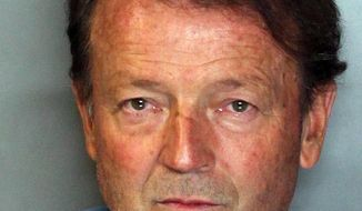 This booking photo released by the Sacramento Sheriff's Department shows Orville Fleming, after he was booked on murder charges on Friday, May 16, 2014 in Sacramento. Fleming, a former California fire battalion chief, is suspected in the stabbing death of his girlfriend and had eluded capture since May 1. (AP Photo/Sacramento County Sheriff's Department)