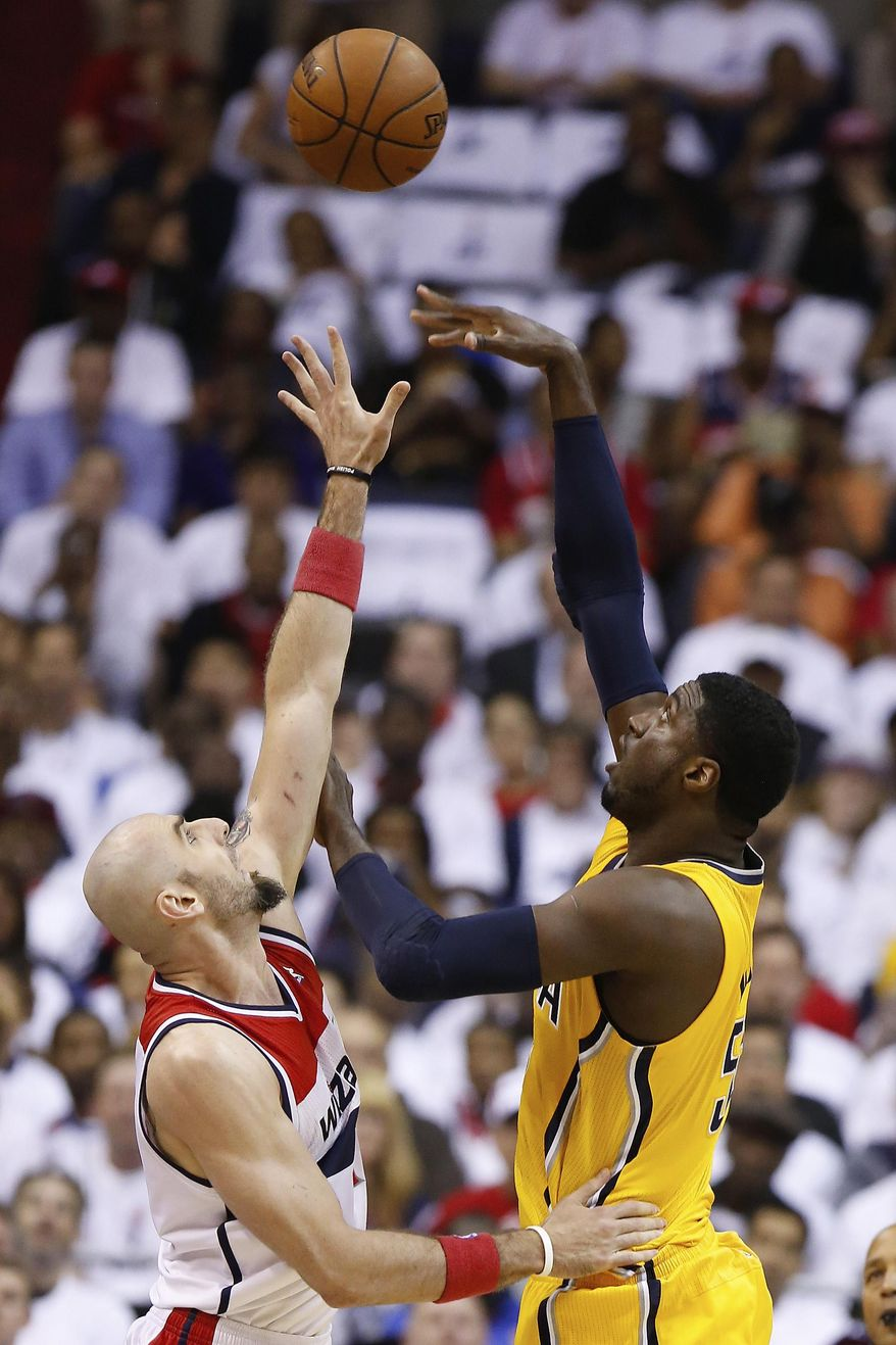 Indiana Pacers center Roy Hibbert (55) shoots over Washington Wizards center Marcin Gortat during the first half in Game 6 of an Eastern Conference semifinal NBA basketball playoff series in Washington, Thursday, May 15, 2014. (AP Photo/Alex Brandon)