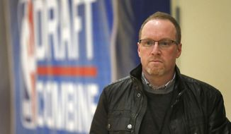 Cleveland Cavaliers general manager David Griffin watches participants at the 2014 NBA basketball draft combine Friday, May 16, 2014, in Chicago. (AP Photo/Charles Rex Arbogast)